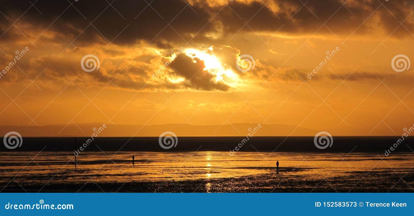 Coucher du soleil sur la plage de Crosby