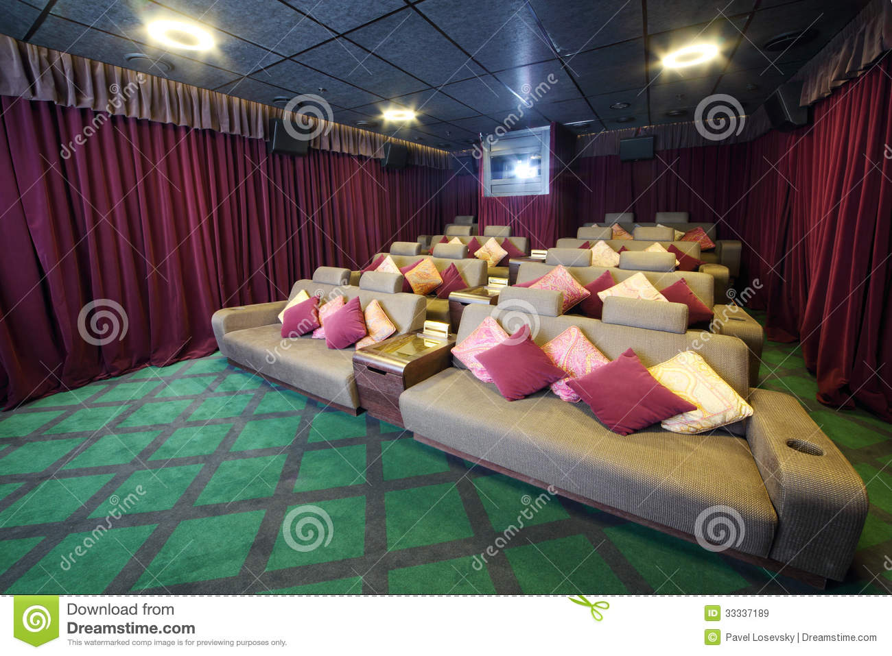 Couches With Cushions And Projector In Small Movie Theate