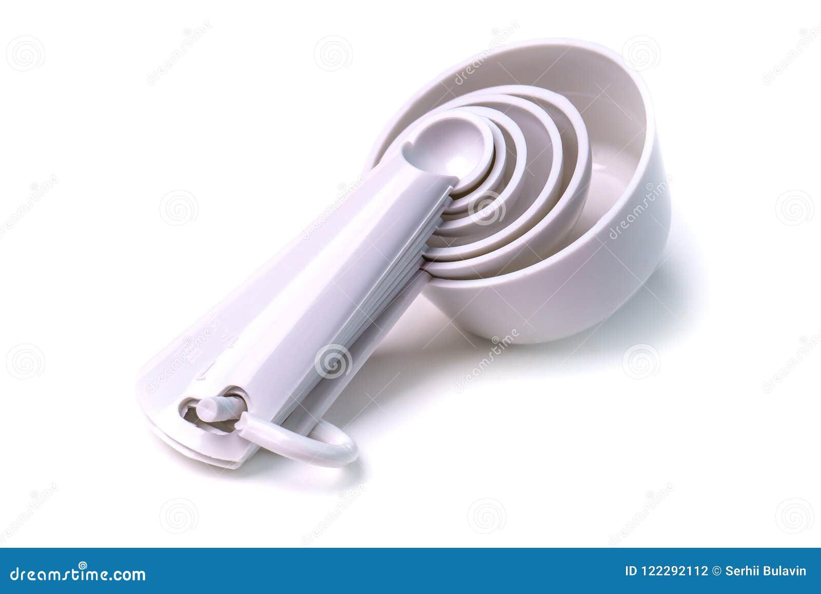 Couleur blanche en plastique réglée de mesure de cuillères et de tasses de table d isolement