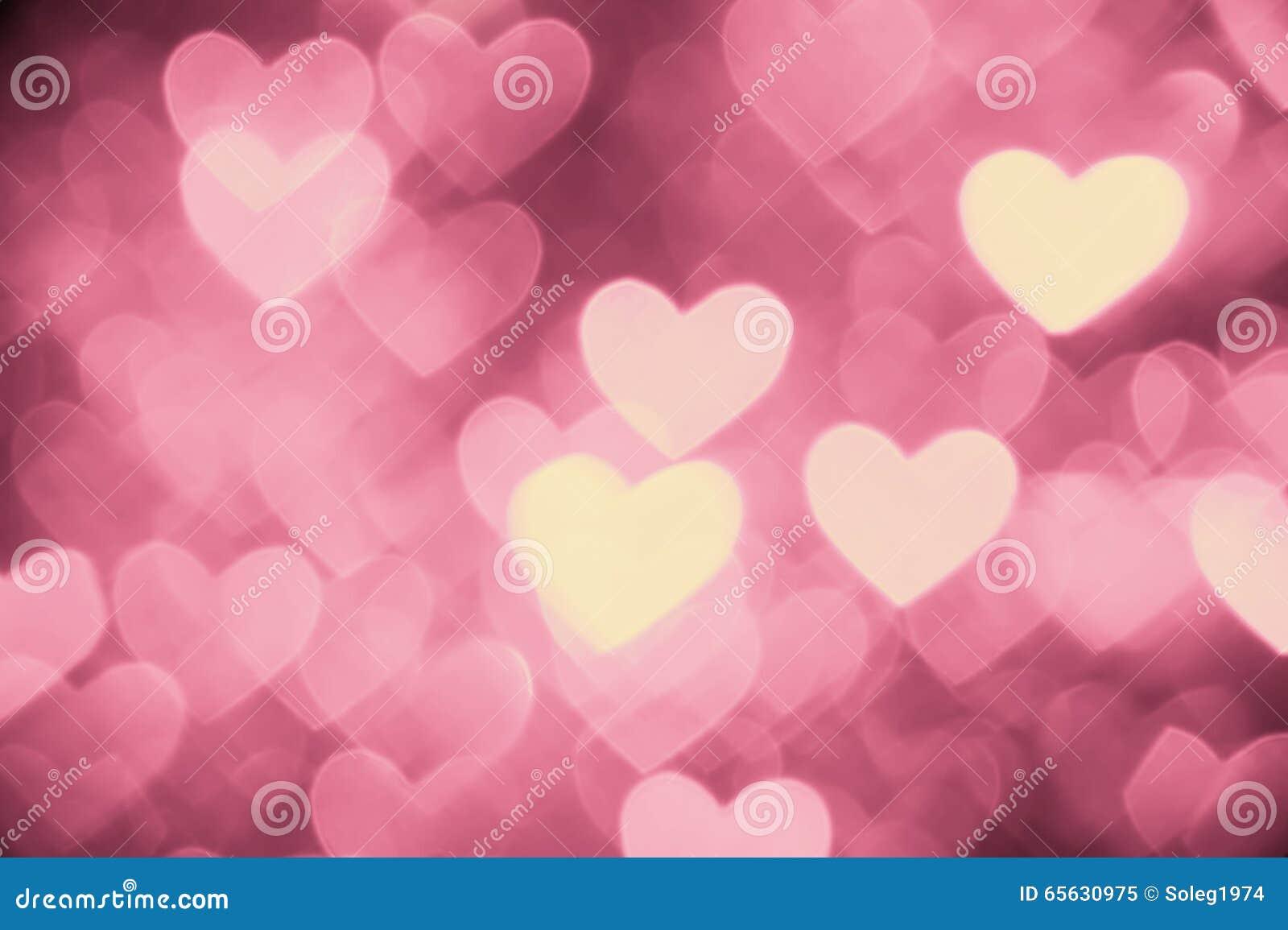 Couleur rose-clair de photo de fond de coeur