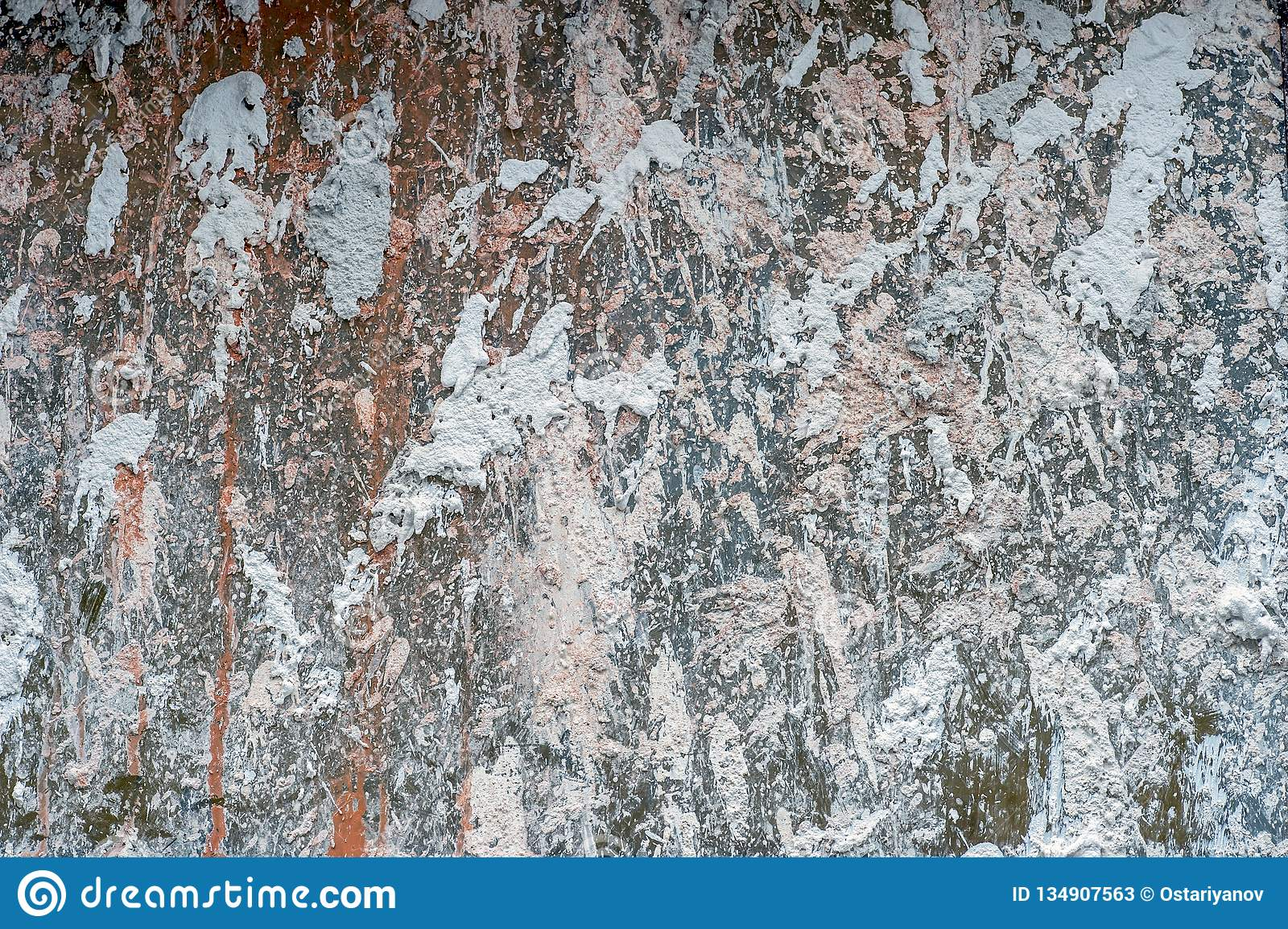 Couleurs Pastel De Mur En Béton éclaboussées Avec Le Plâtre