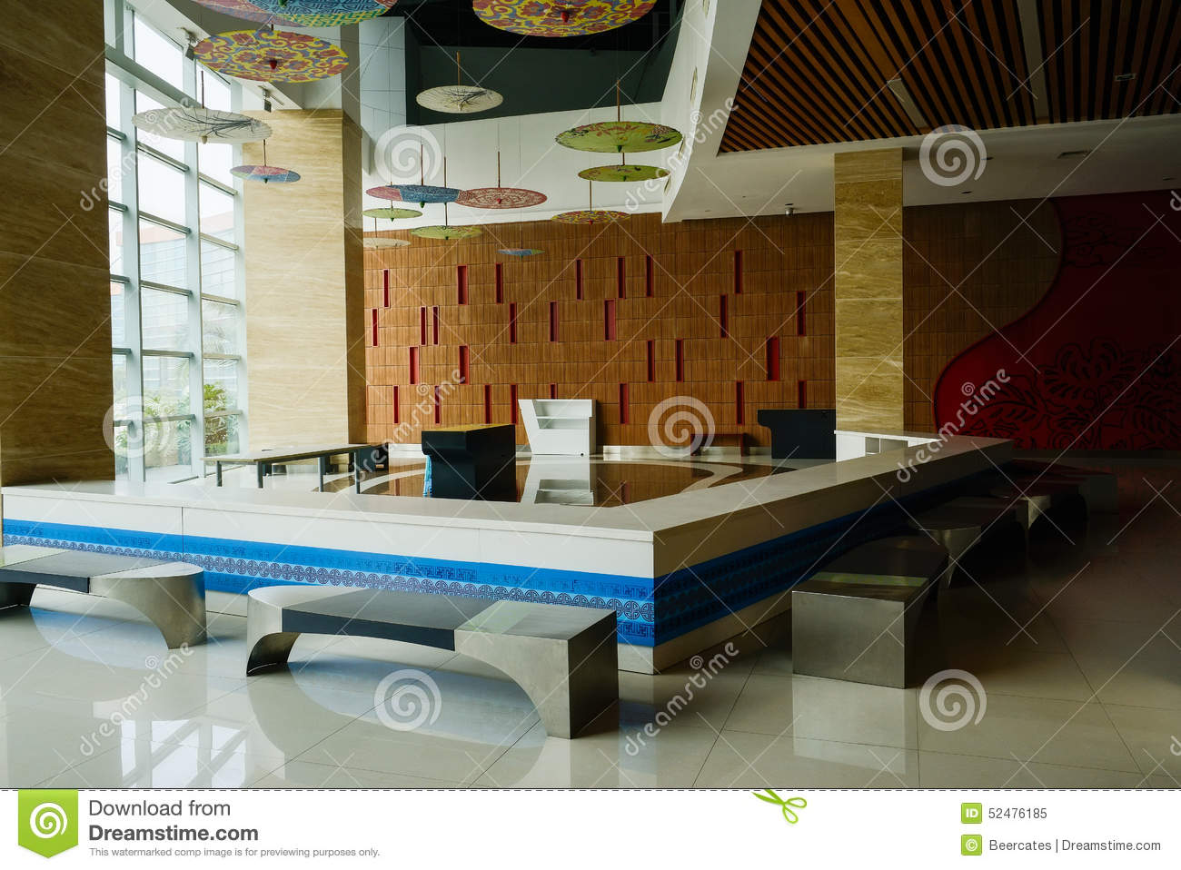 Counter and benches near large glass wall of spacious hall for Large glass wall