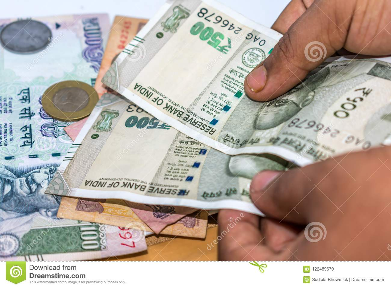 Counting Indian rupee currency,money