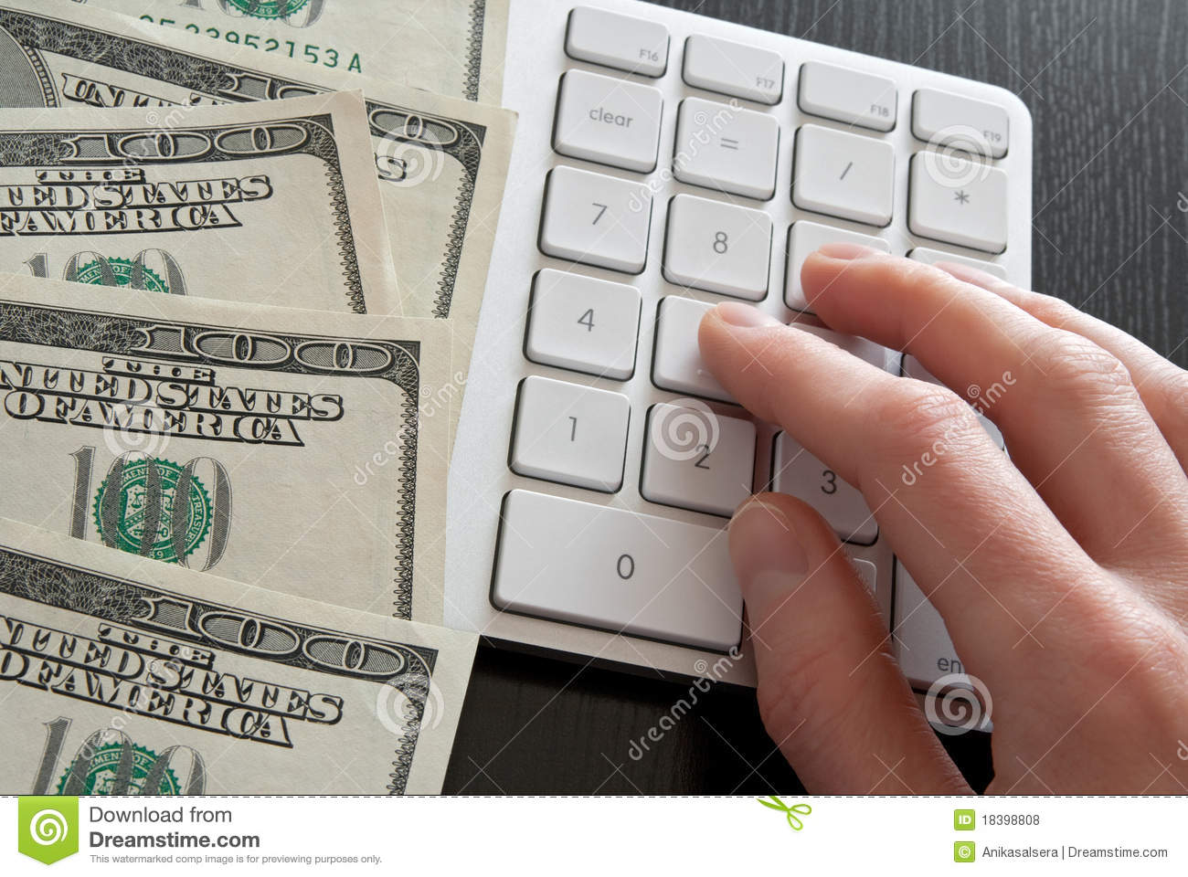 Counting Money On Computer Calculator Royalty Free Stock Photos - Image: 18398808
