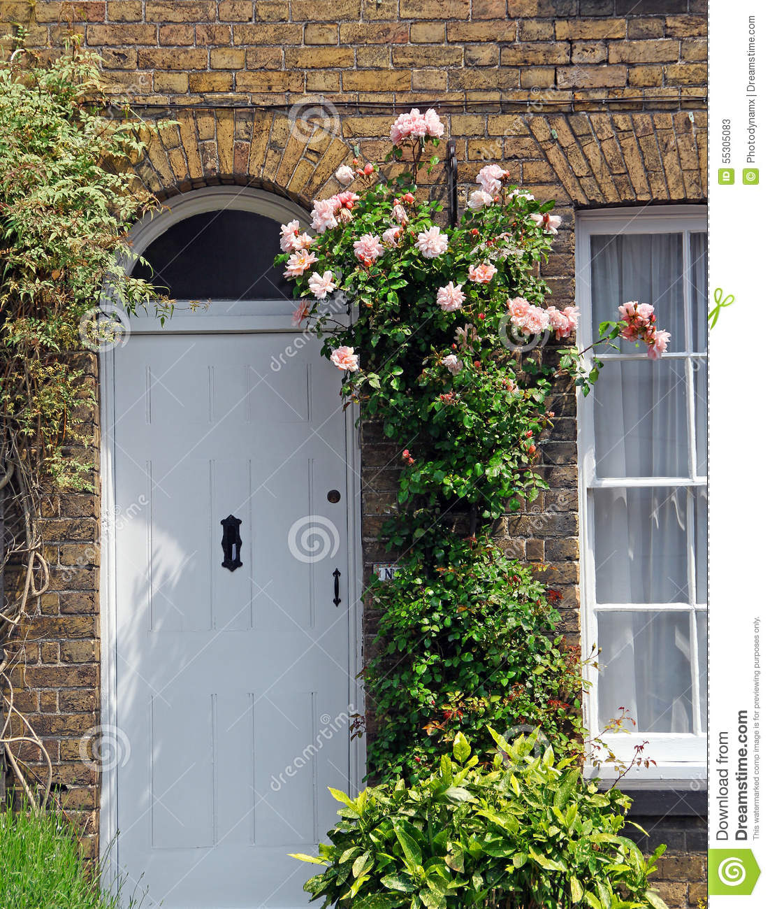 Country cottage door roses & Country Cottage Door Roses Stock Photo - Image: 55305083 Pezcame.Com