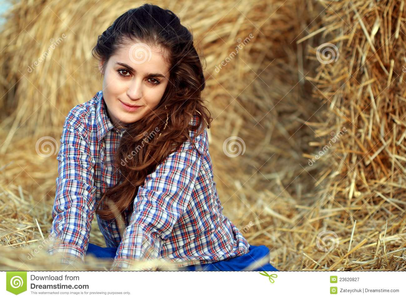 Country Girl Smiling At Haystack Royalty Free Stock