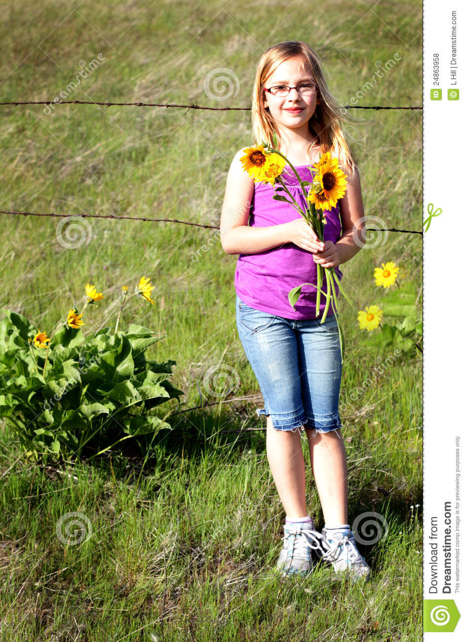 country girl and wild flowers royalty free stock photos