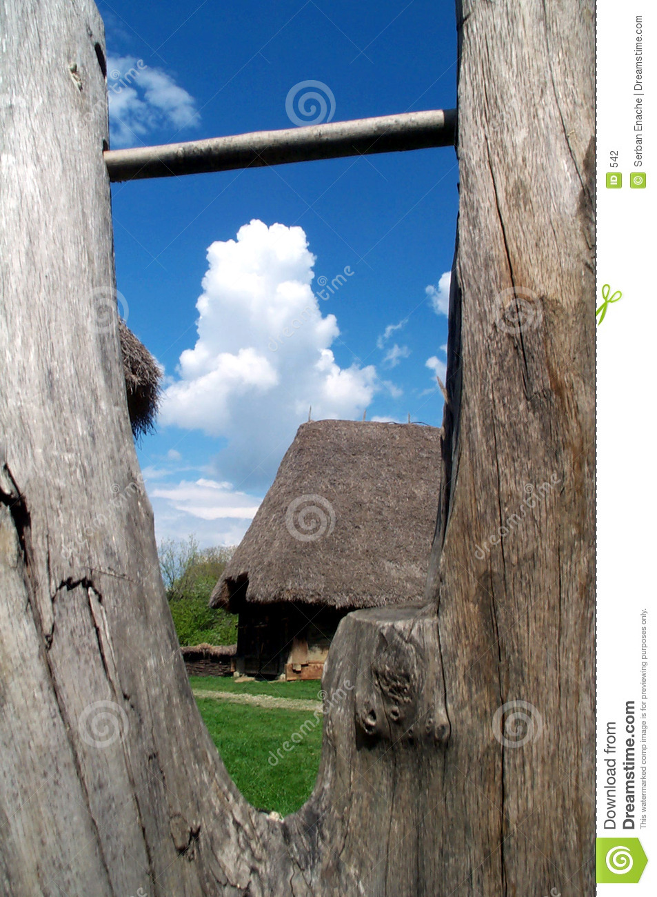 Country house seen through wooden fence