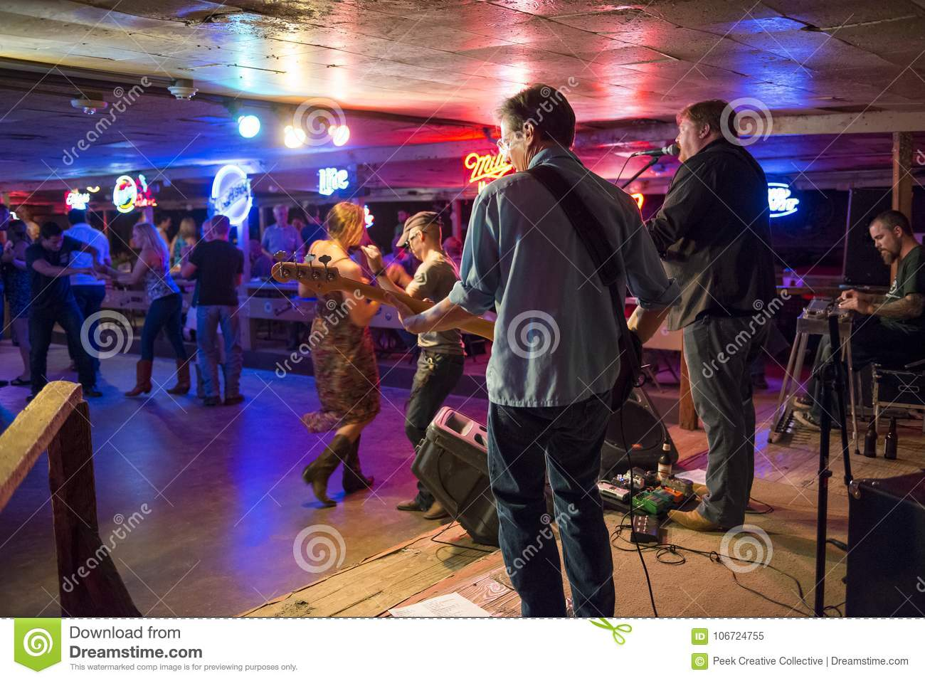Country music band playing and people dancing in the Broken Spoke dance hall in Austin, Texas