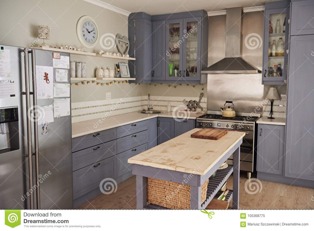Country Style Kitchen With With An Island In A Home Stock Image