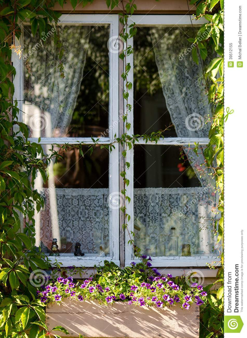 Country style window with flowers and curtains