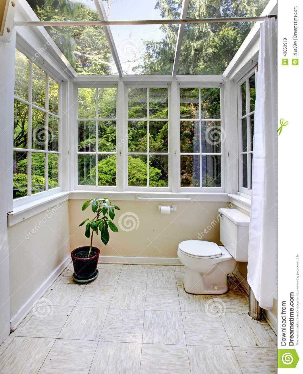 Countryside Bathroom With Glass Wall And Ceiling Stock
