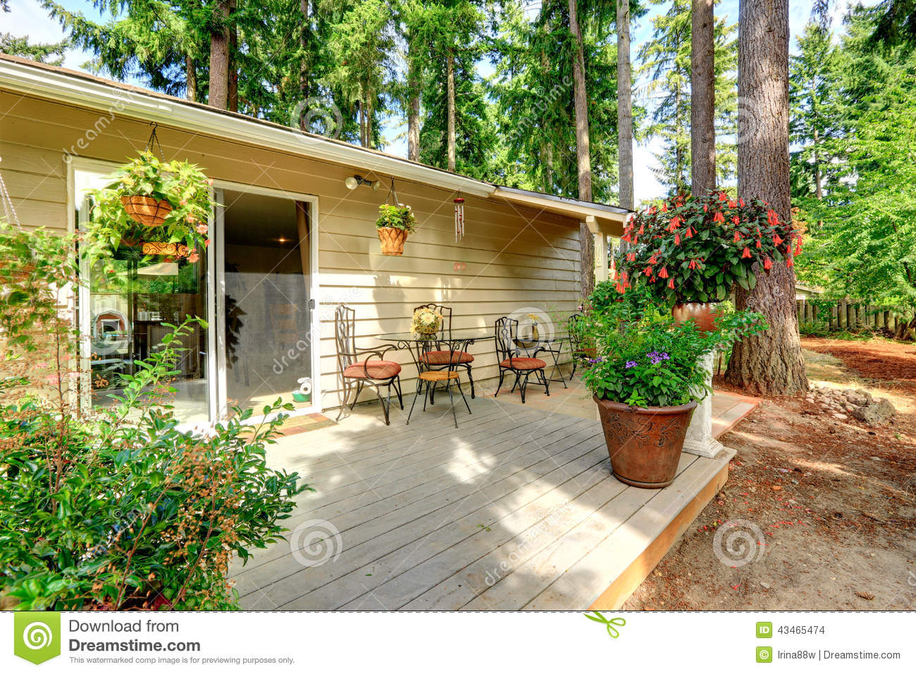 Countryside house backyard with flower pots stock photo - Casa chaise de jardin ...