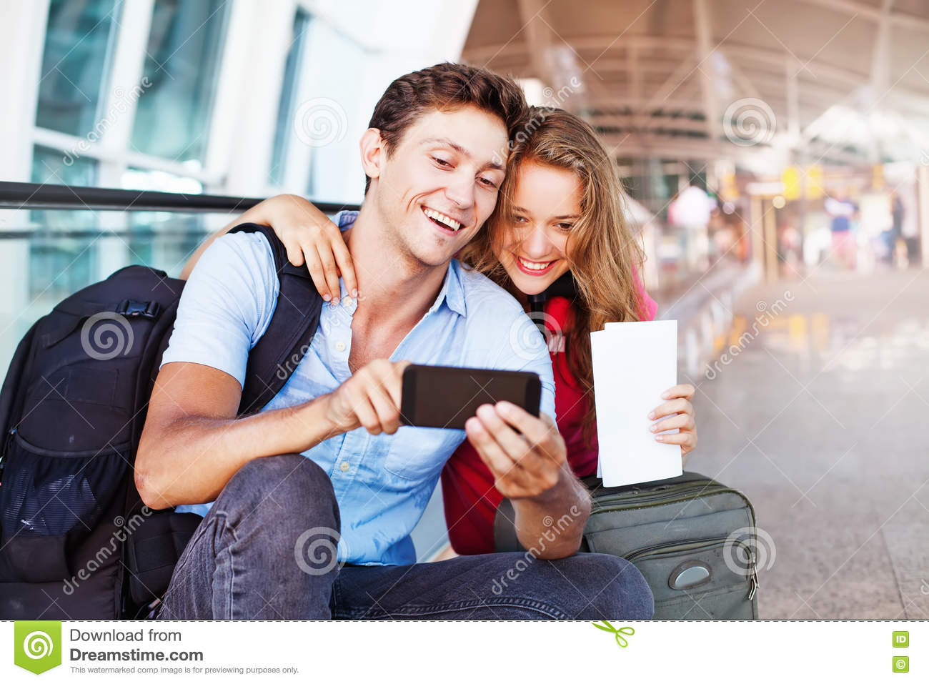 Couple in airport using travel app