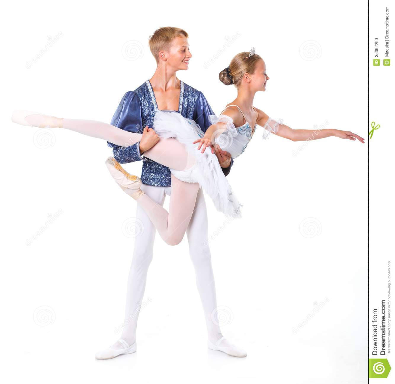 Couple of young ballet dancers posing over isolated white background.