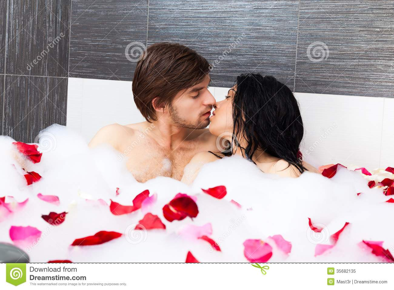 Young Couple In Bathroom Taking Bath Together Royalty Free Stock Photo