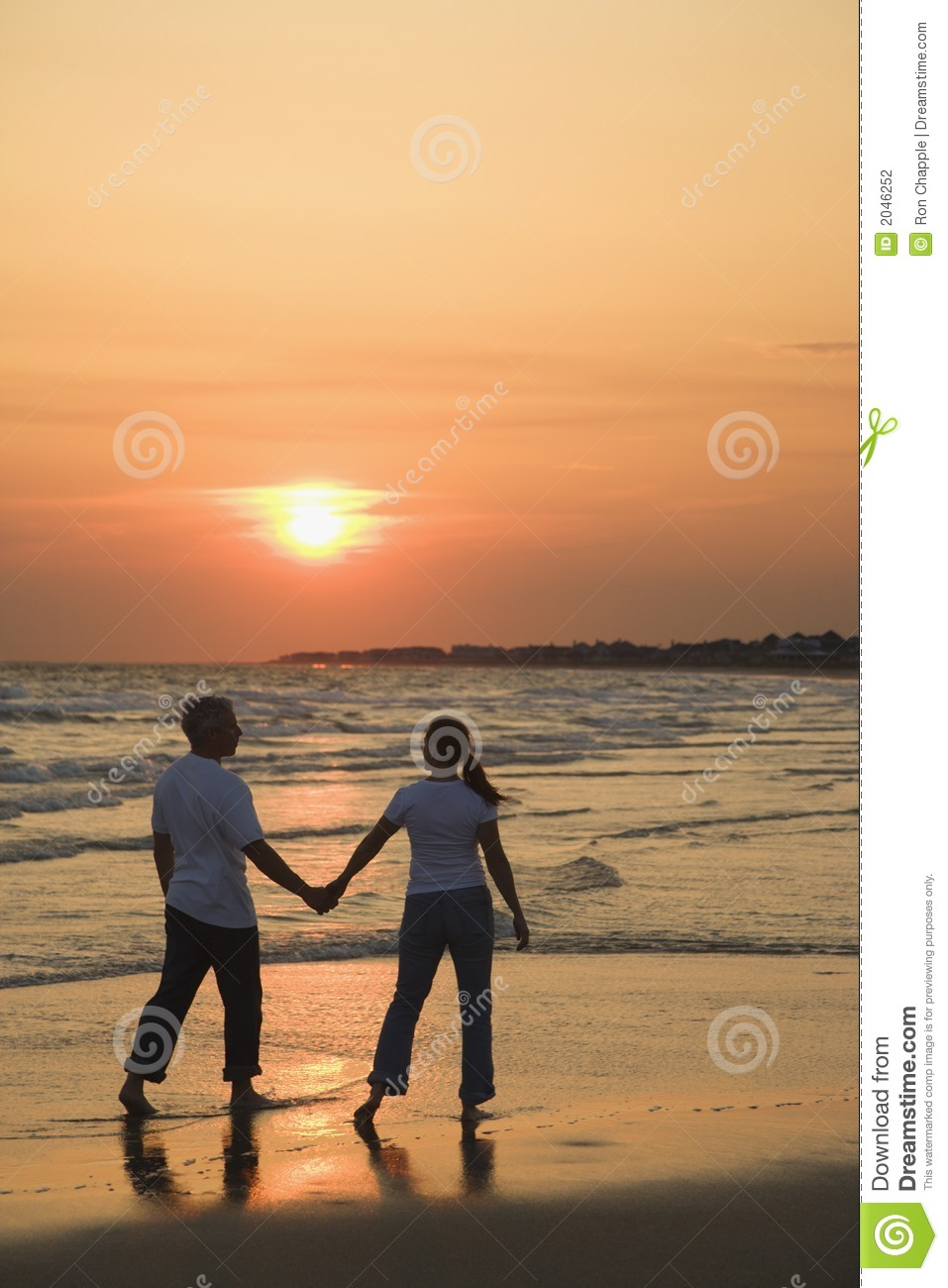 Couple on beach at sunsest.