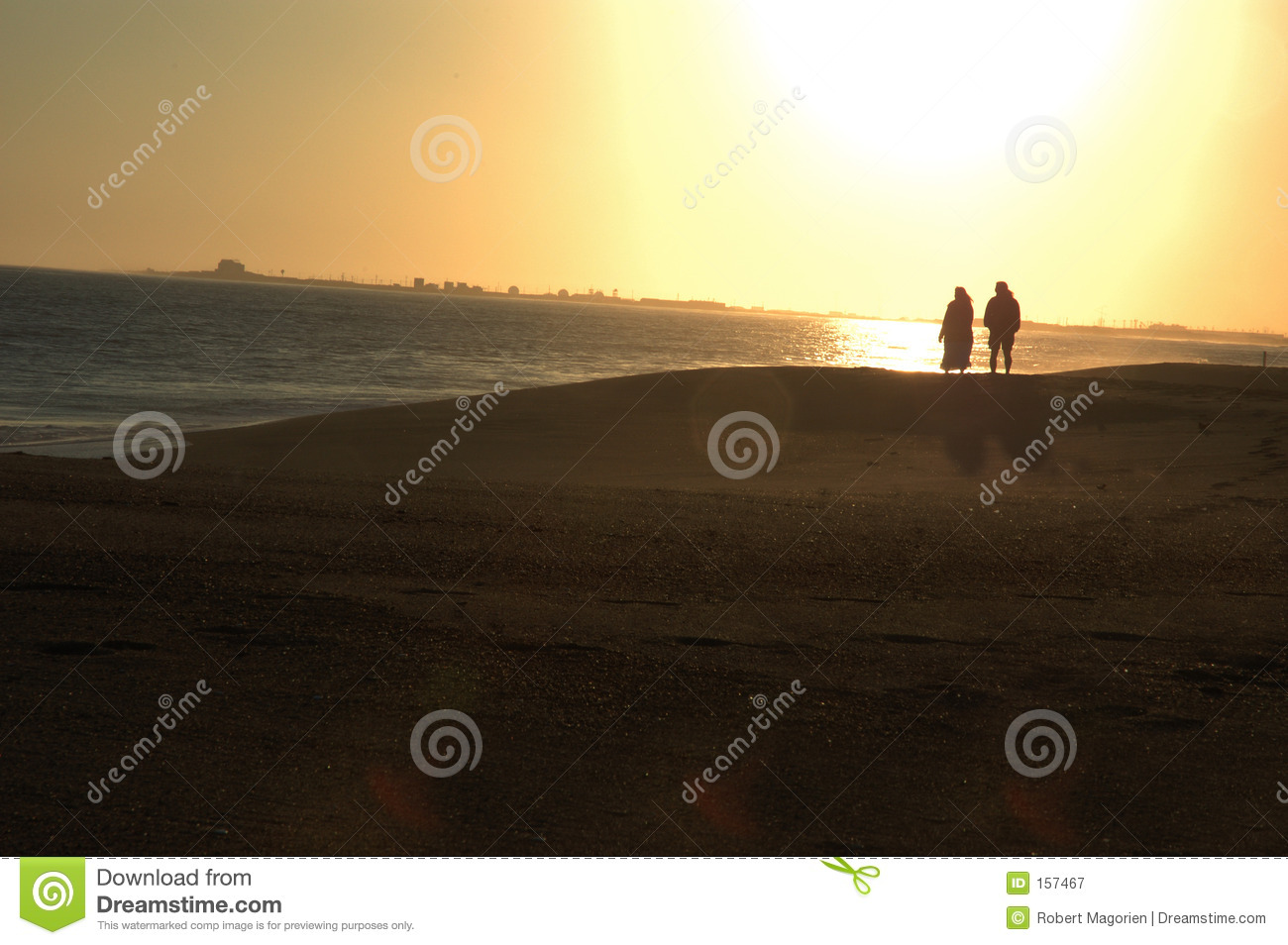 Couple at beach at sunset