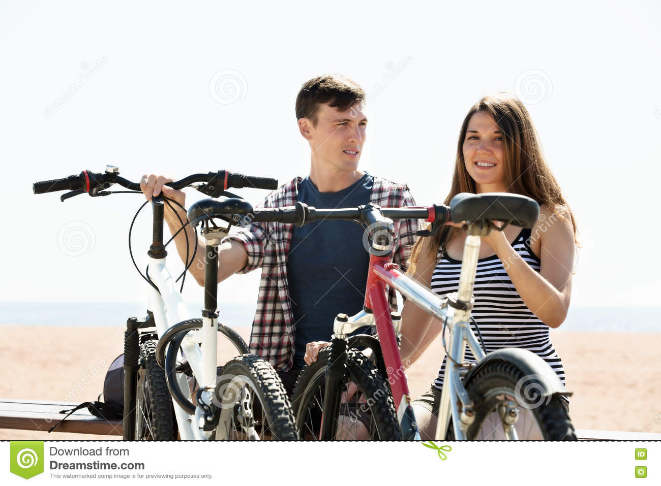 Couple with bikes on beach
