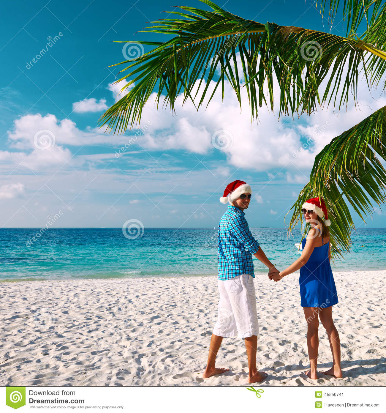 Couple At The Beach Stock Image Image Of Caucasian: Couple In Blue Clothes On A Beach At Christmas Stock Image