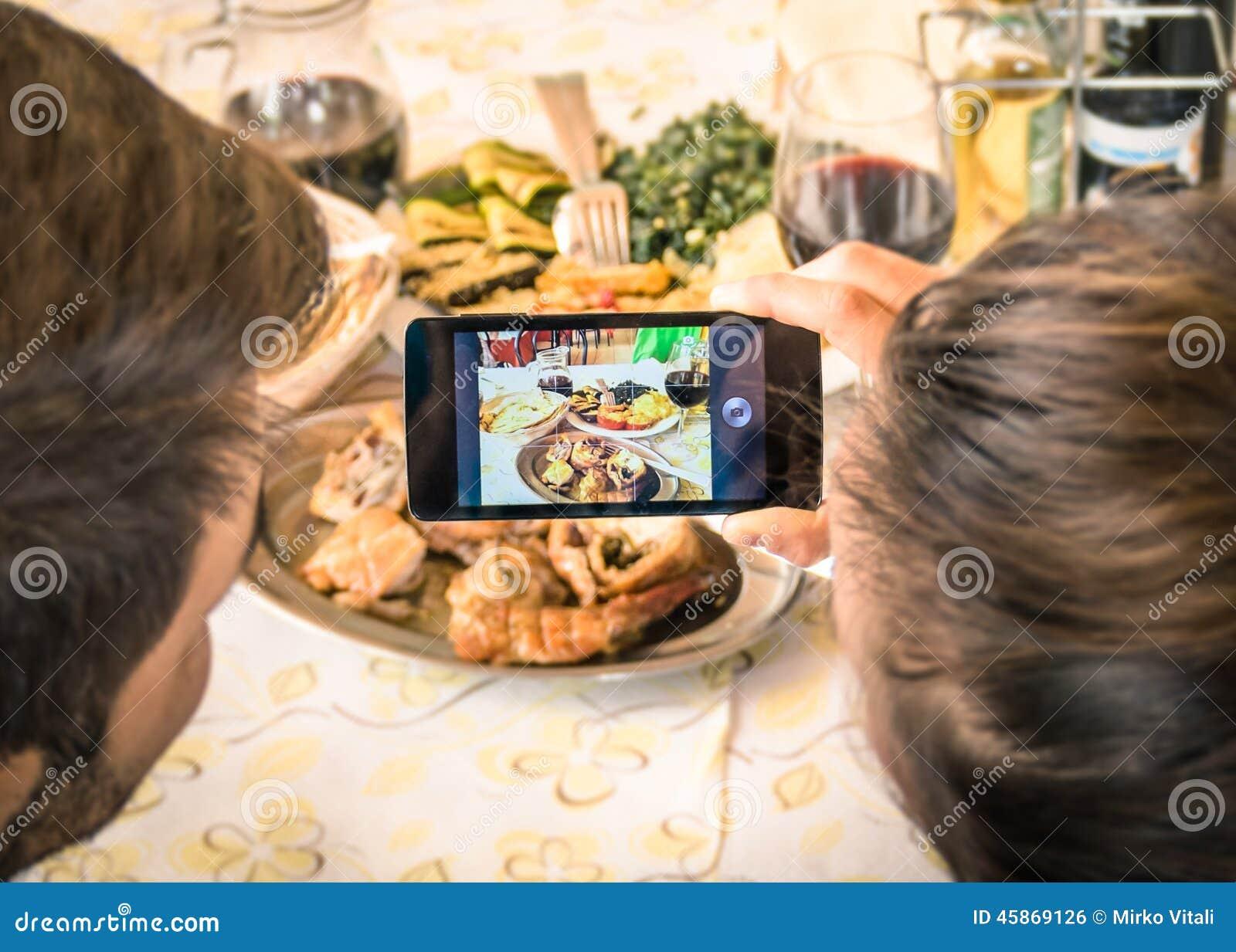 Couple of boyfriend and girlfriend taking a food selfie