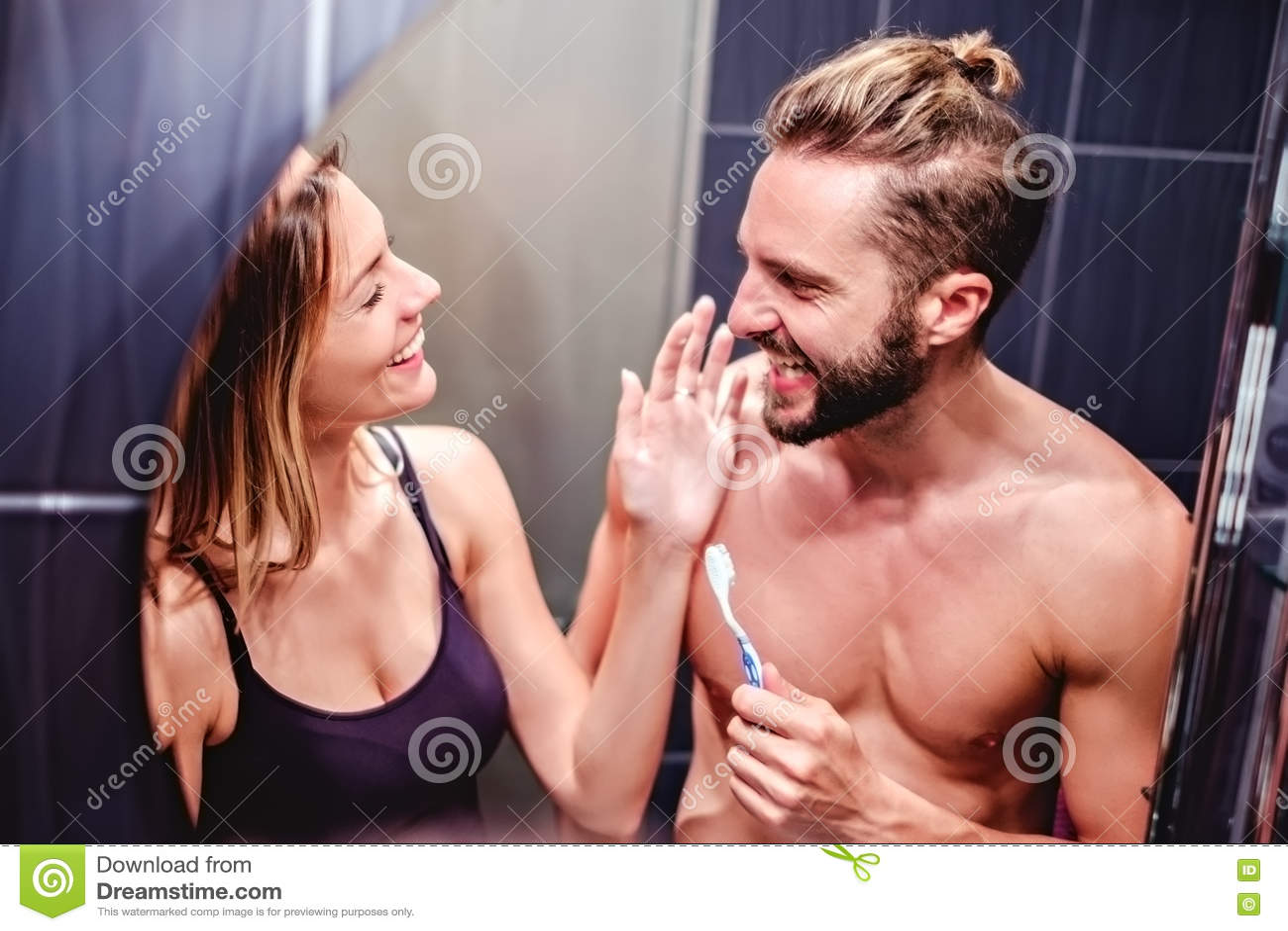 Couple Brushing Teeth And Having Fun Stock Photo Image Of