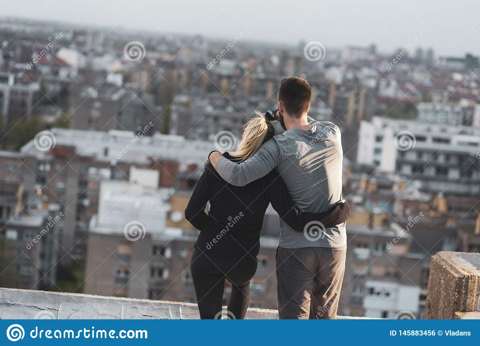 Couple on a building rooftop terrace