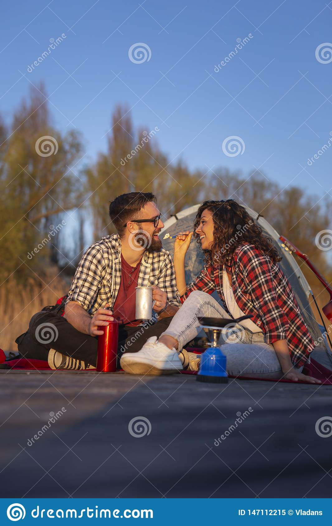 Couple`s camping dinner