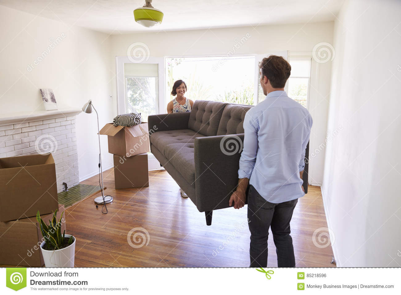 Moving day couple with their stuff inside the cardboard When is the best time to move house
