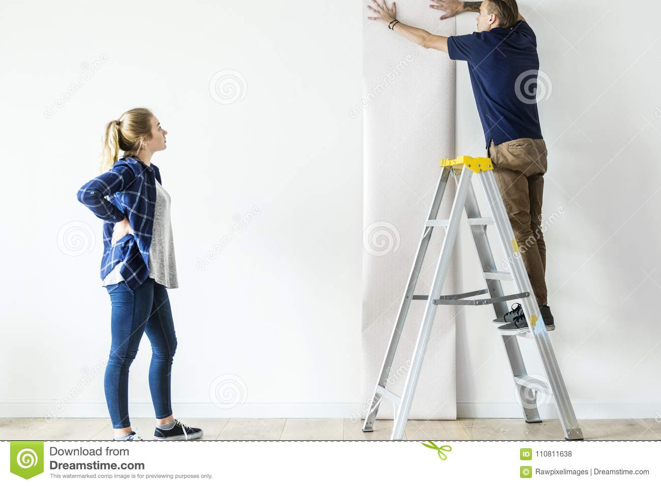 Couple choosing house wallpaper together