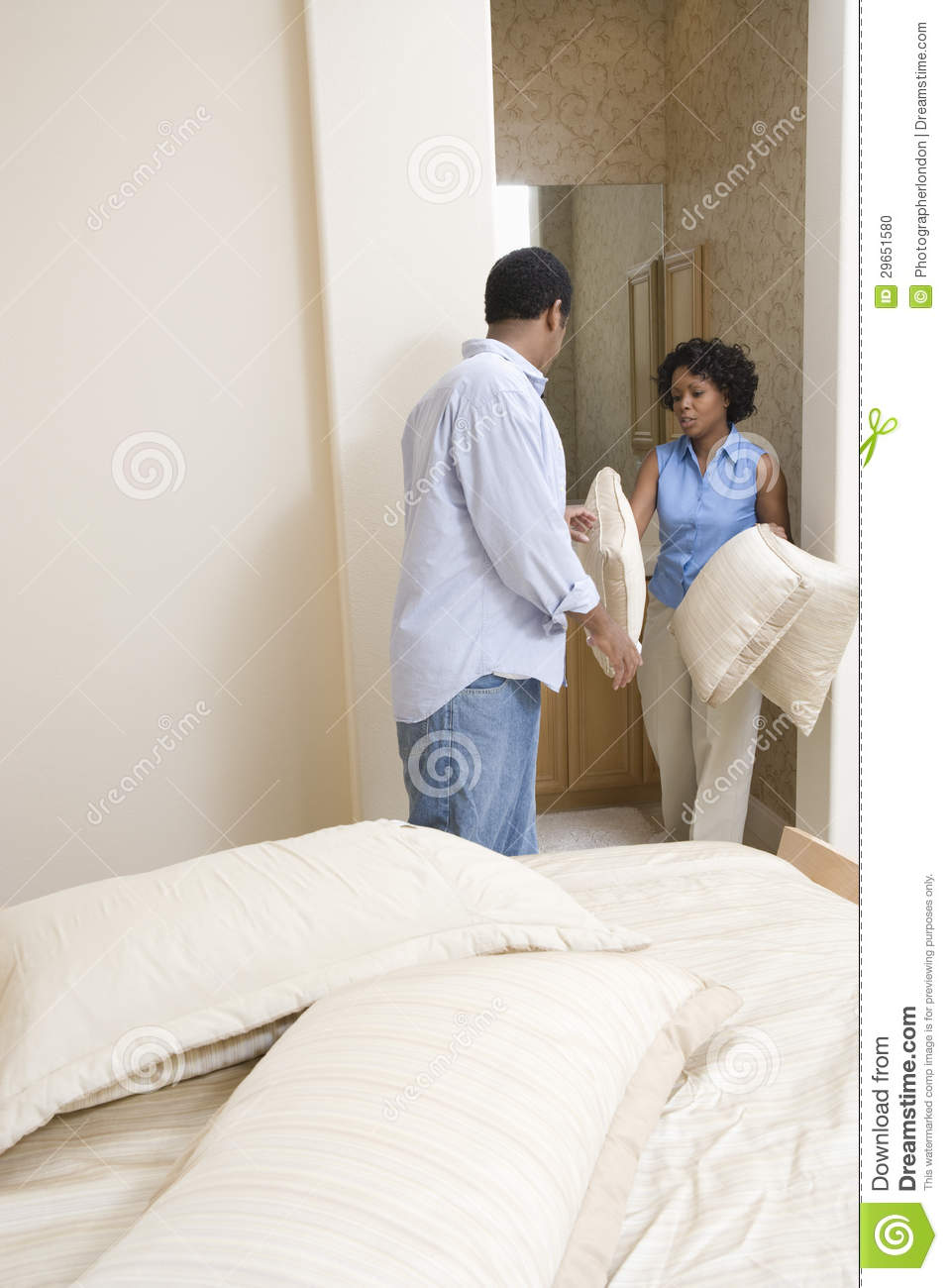Couple choosing pillows for their bed stock photo image for Choosing pillows for bed