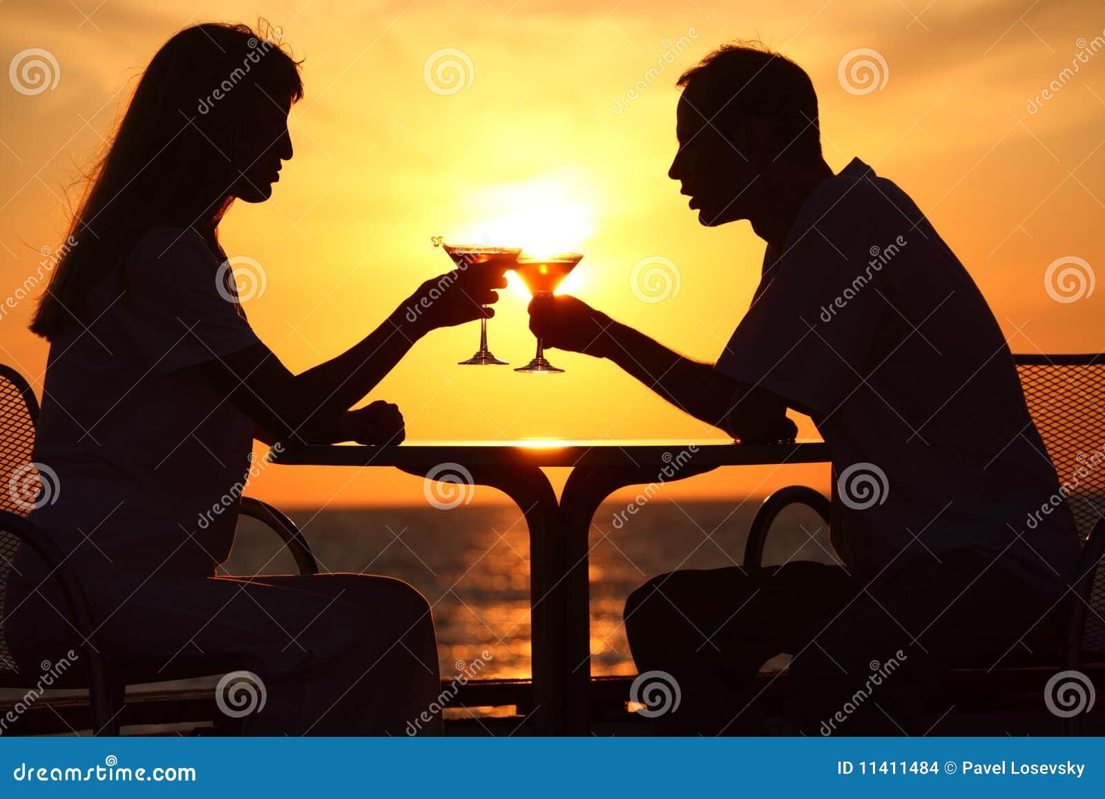 couple clink glasses on sunset outside stock images image 11411484. Black Bedroom Furniture Sets. Home Design Ideas