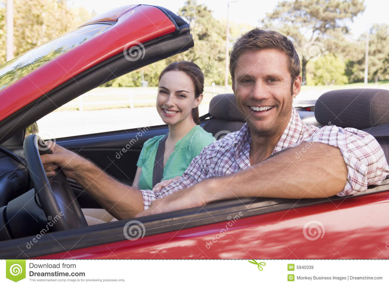 couple in convertible car smiling royalty free stock images image 5940339. Black Bedroom Furniture Sets. Home Design Ideas