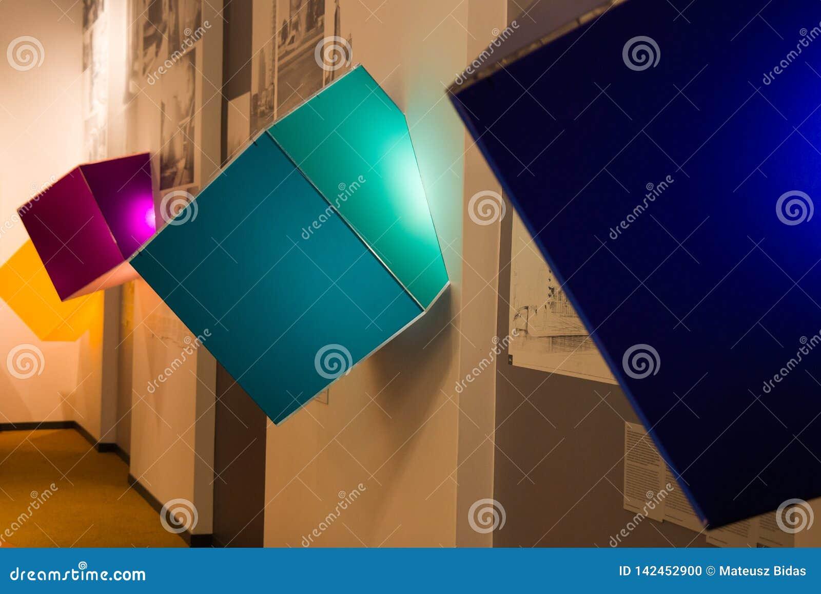 A couple corolful luminous 3D cubes indoor