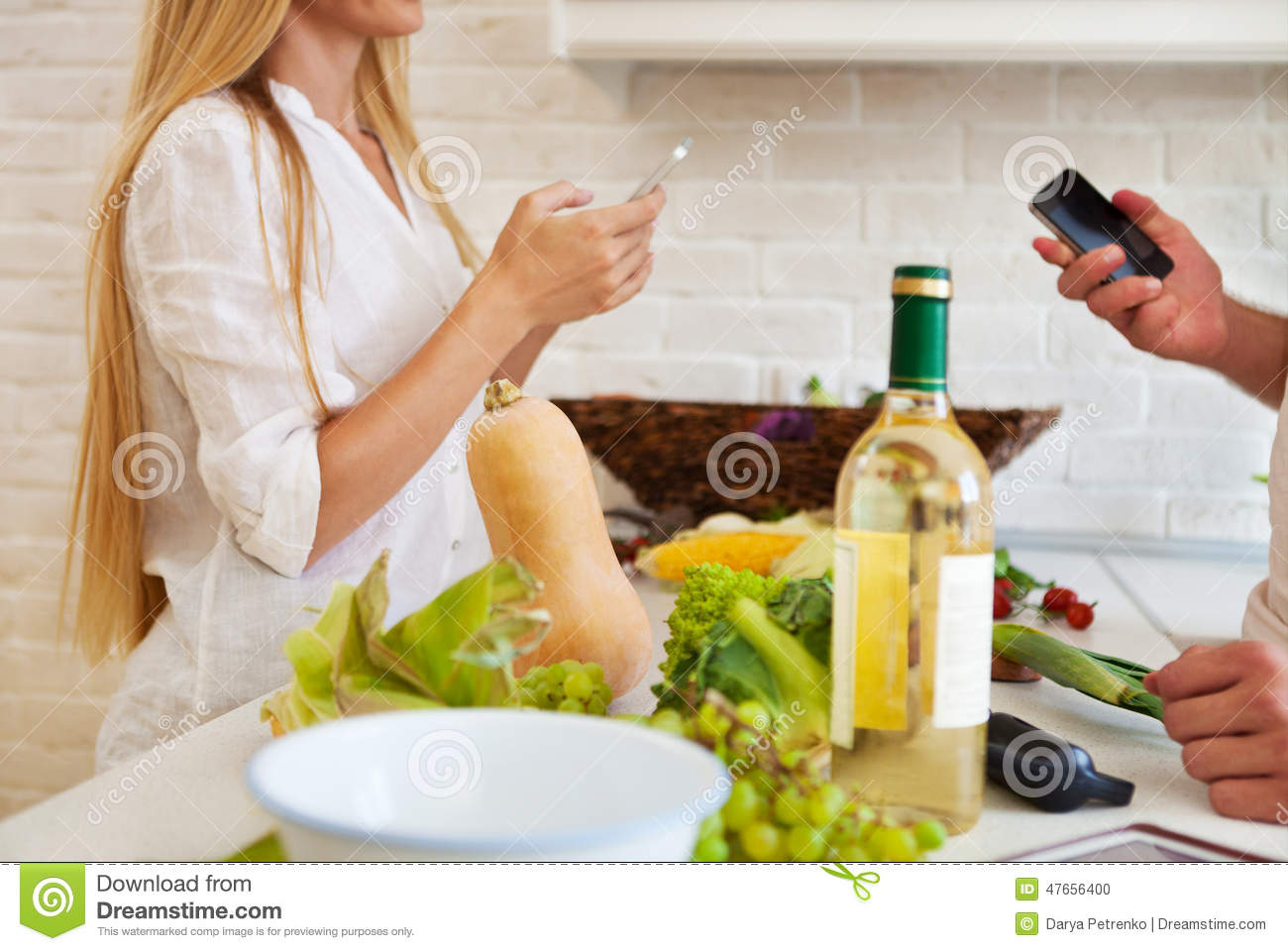 Couple cutting vegetables at the kitchen. Couple preparing dining