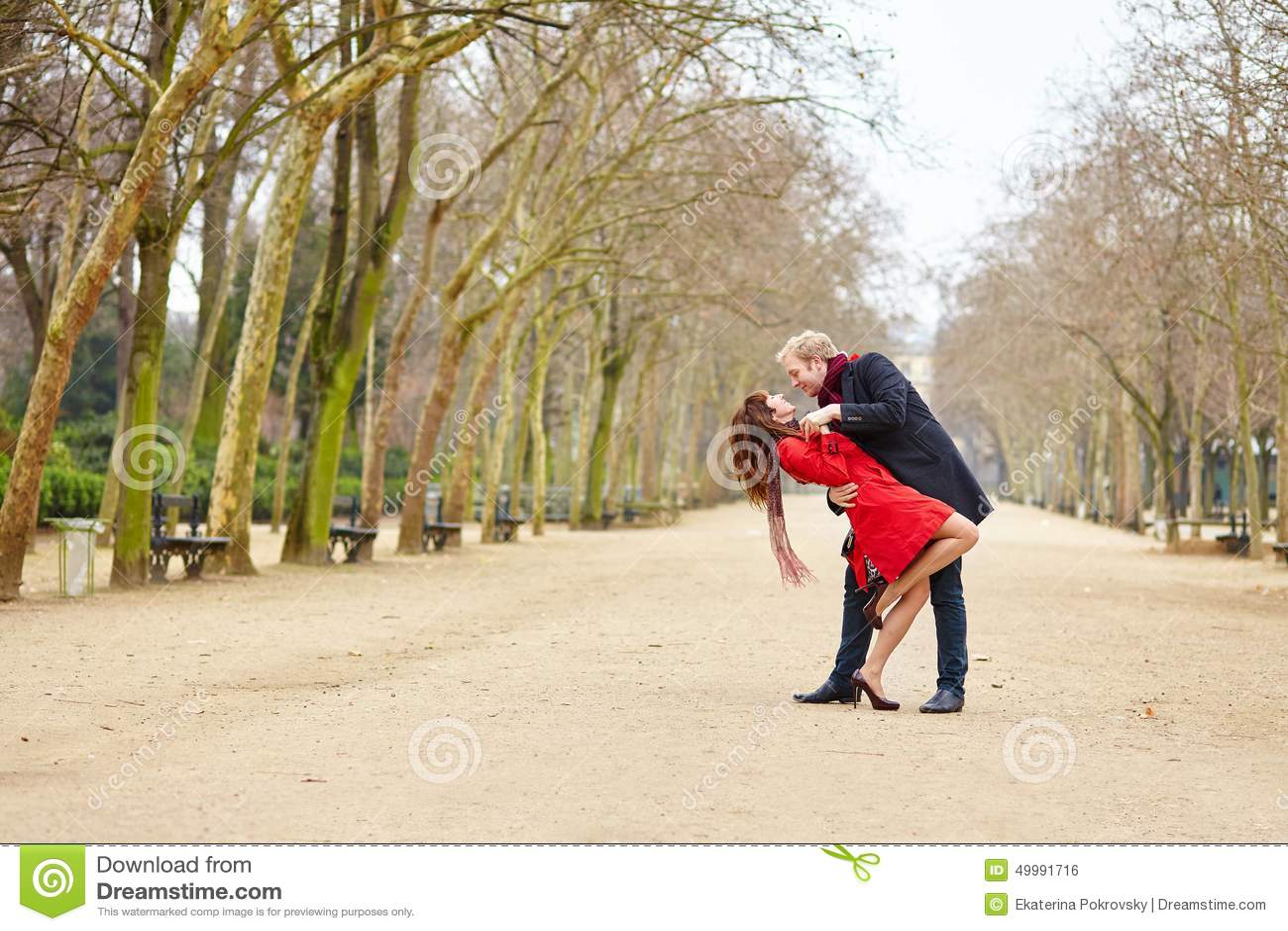 Couple dancing in the Luxembourg garden of Paris