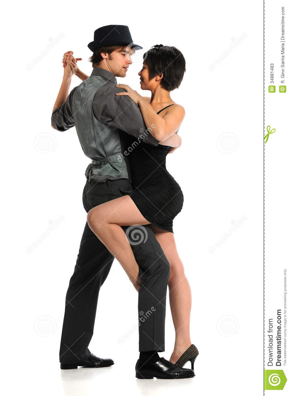 Young couple dancing tango isolated over white background.