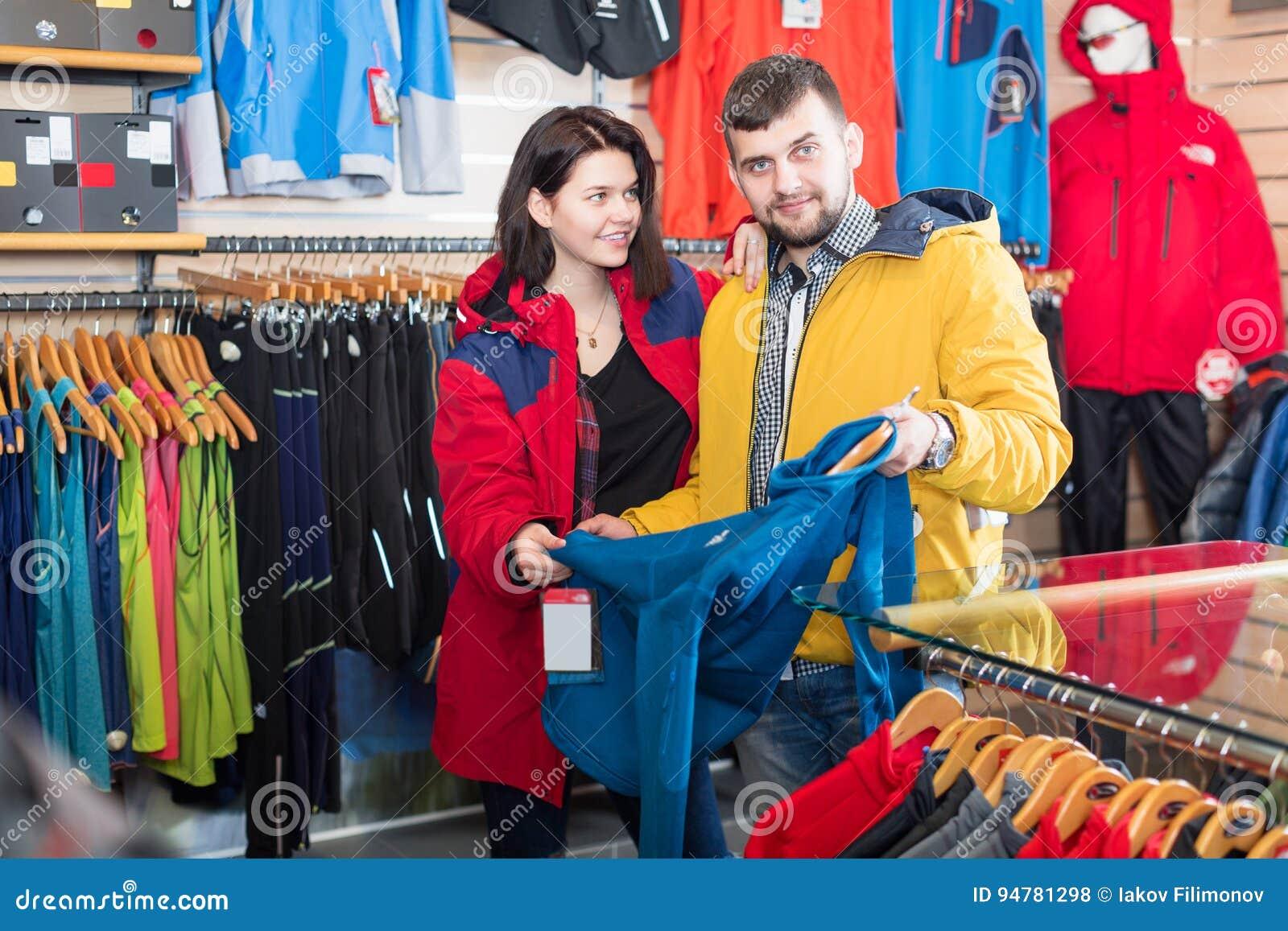 Couple Deciding On Track Jacket Stock Photo - Image of