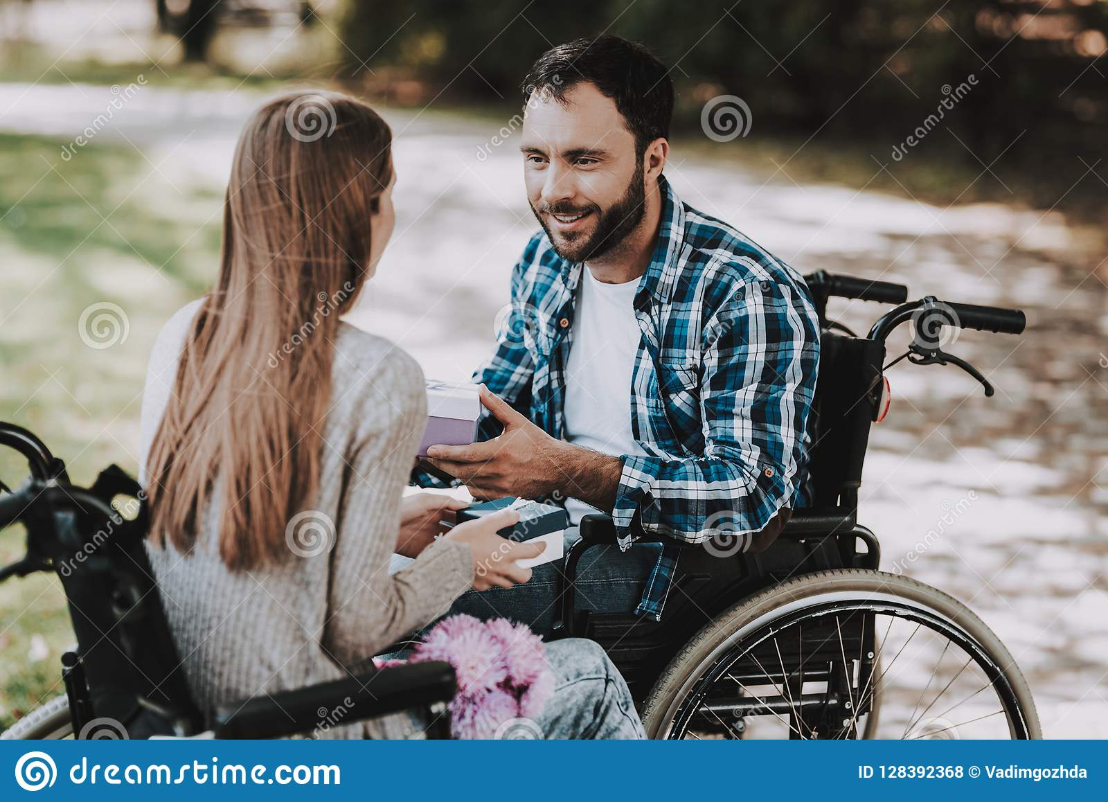 couple-disabled-people-exchanging-gifts-park-couple-disabled-people-exchanging-gifts-park-disabled-young-man-woman-128392368.jpg?profile=RESIZE_400x