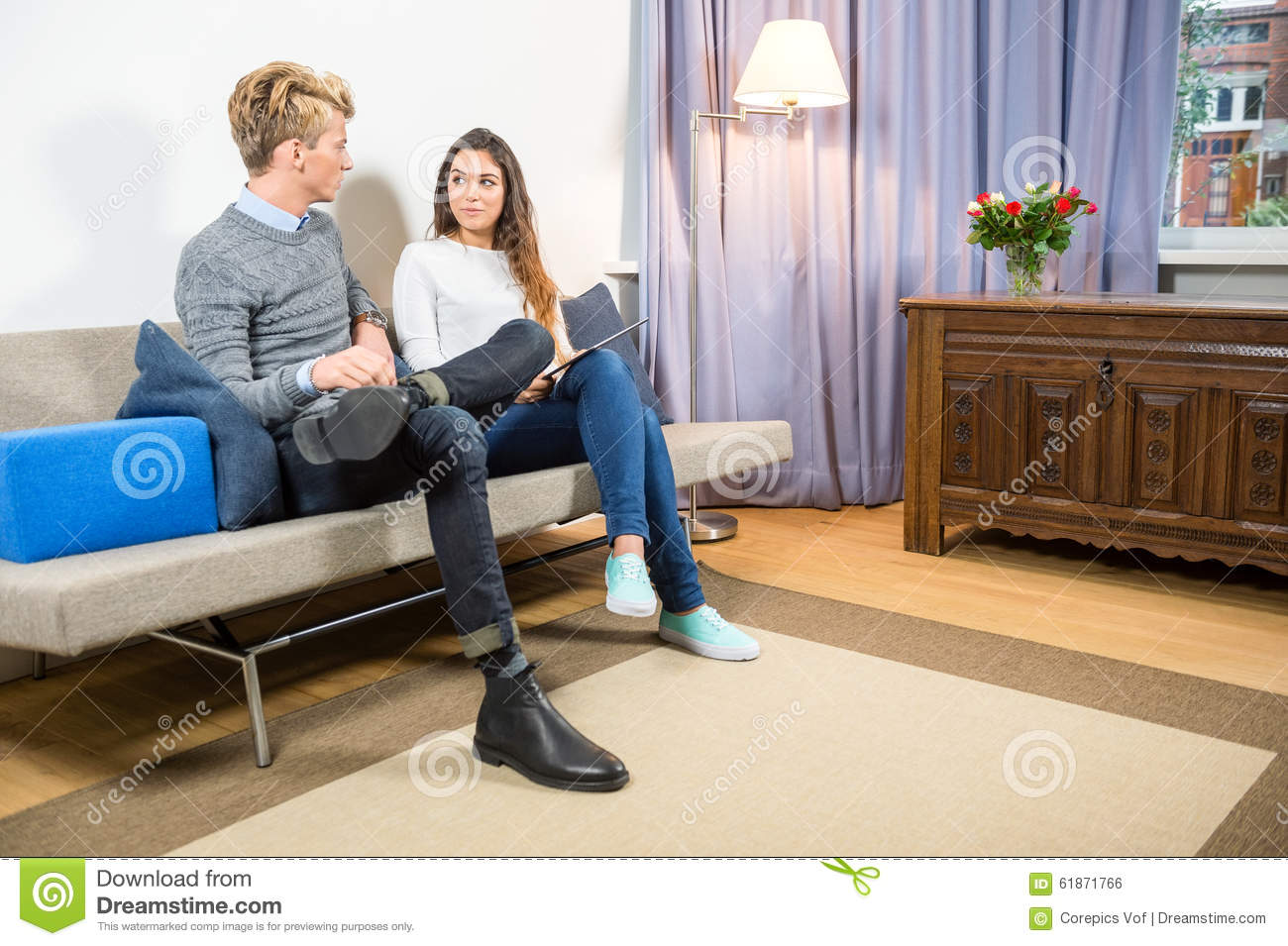 Couple discussing home finance on sofa stock photo image for Sofa 0 finance