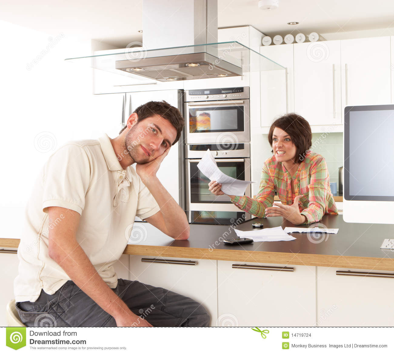 Couple discussing personal finances in kitchen stock for Kitchen 0 finance b q