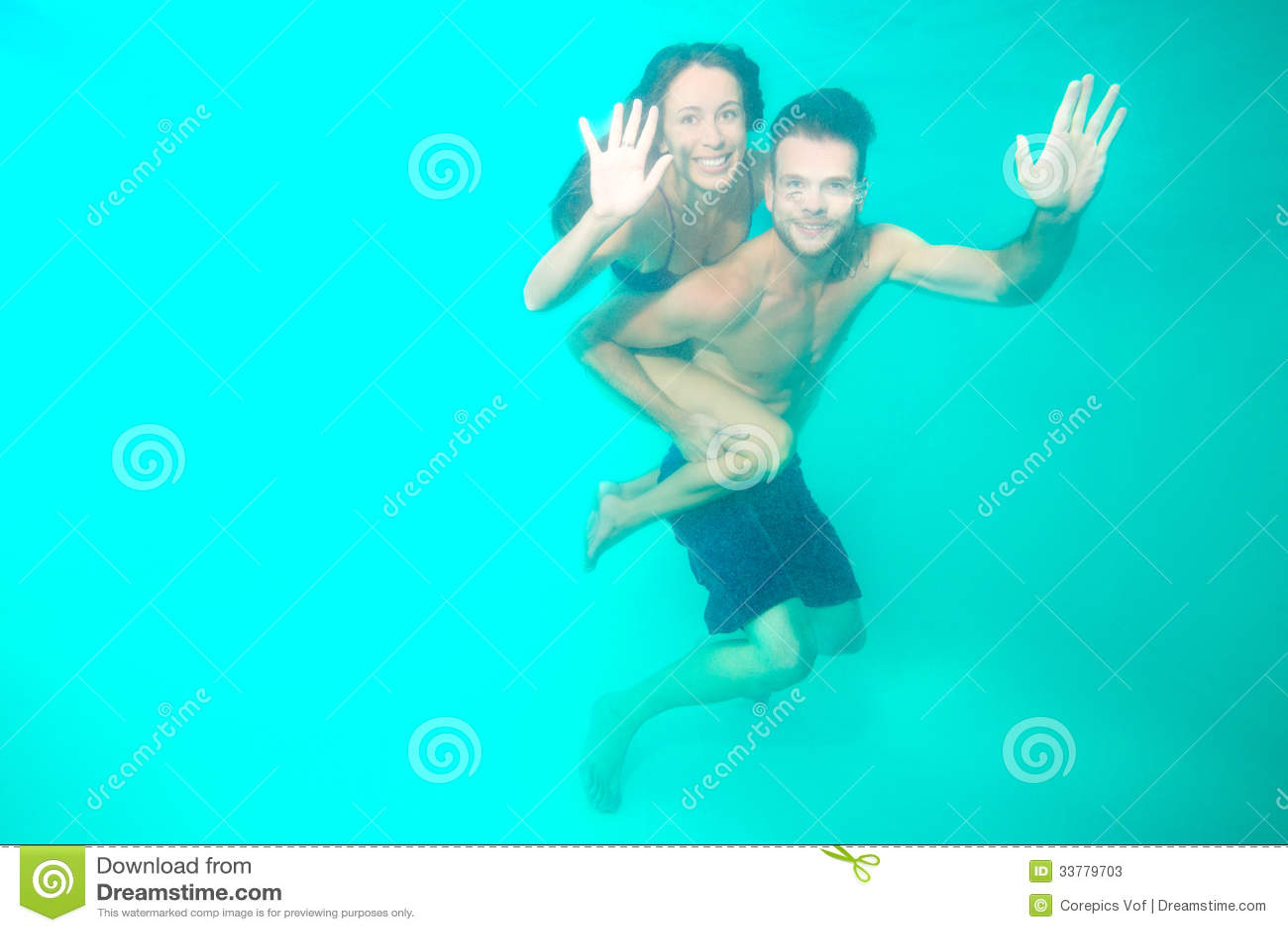 Couple diving underwater
