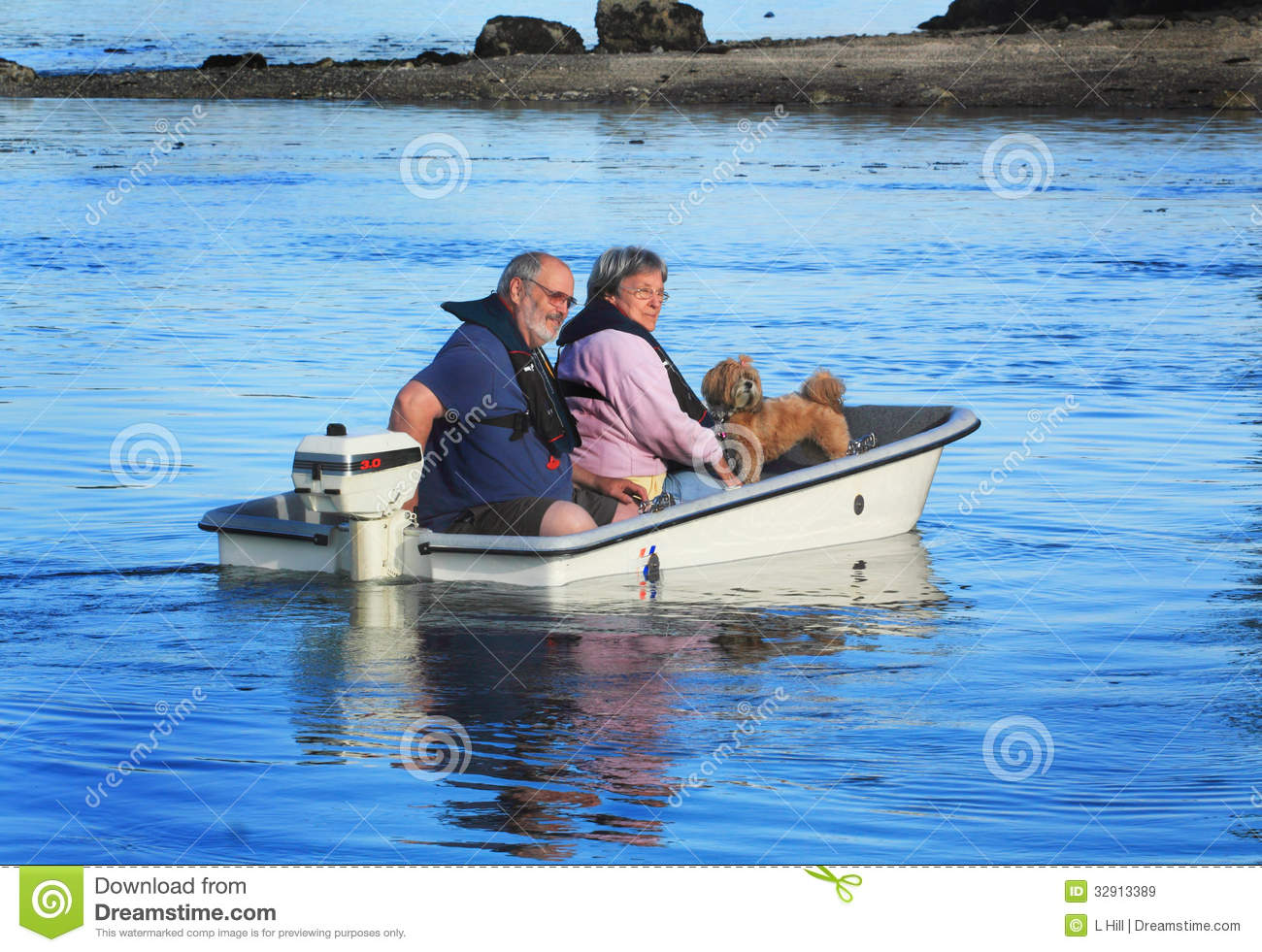 Couple with dog on small boat royalty free stock images for Small motor boat cost