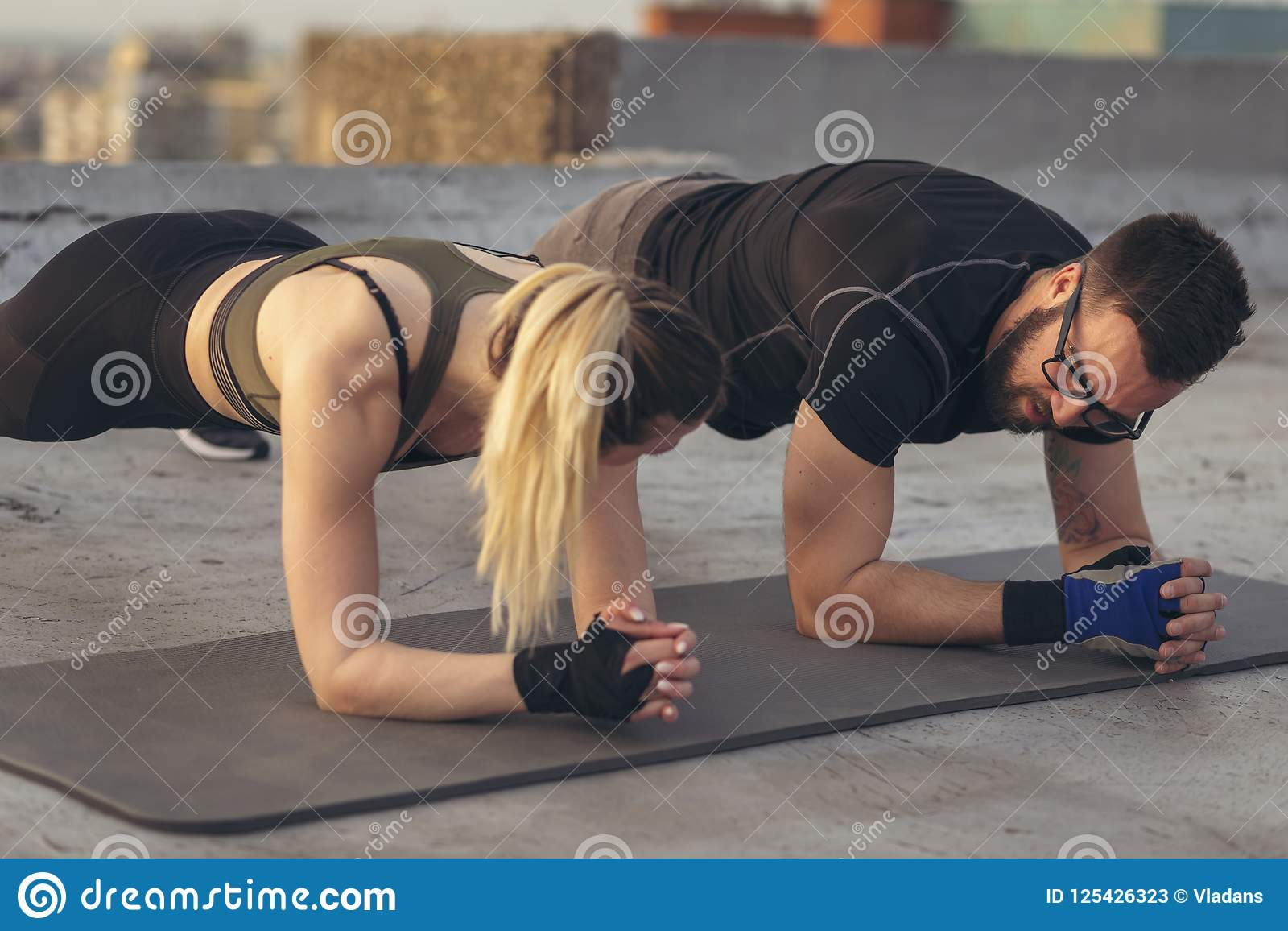 Couple doing a plank exercise