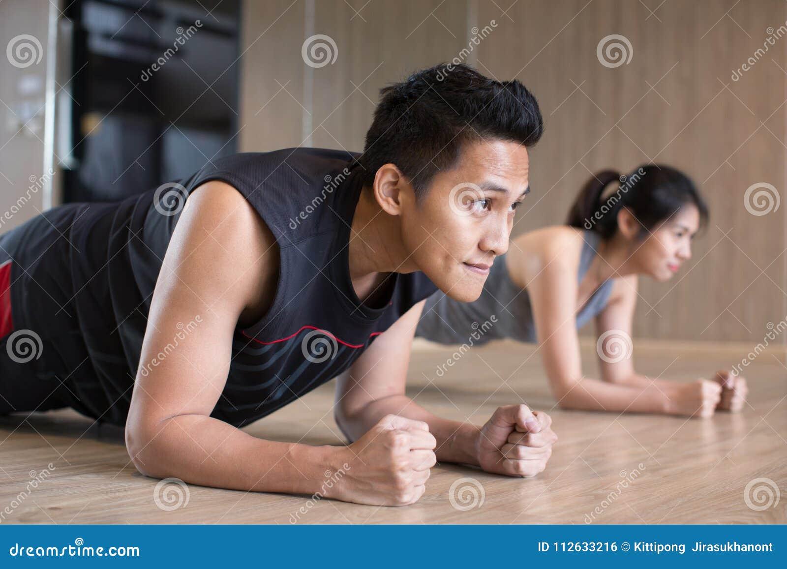 Couple doing plank