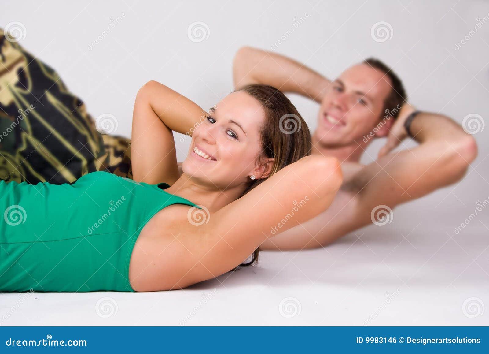 Couple doing sit ups