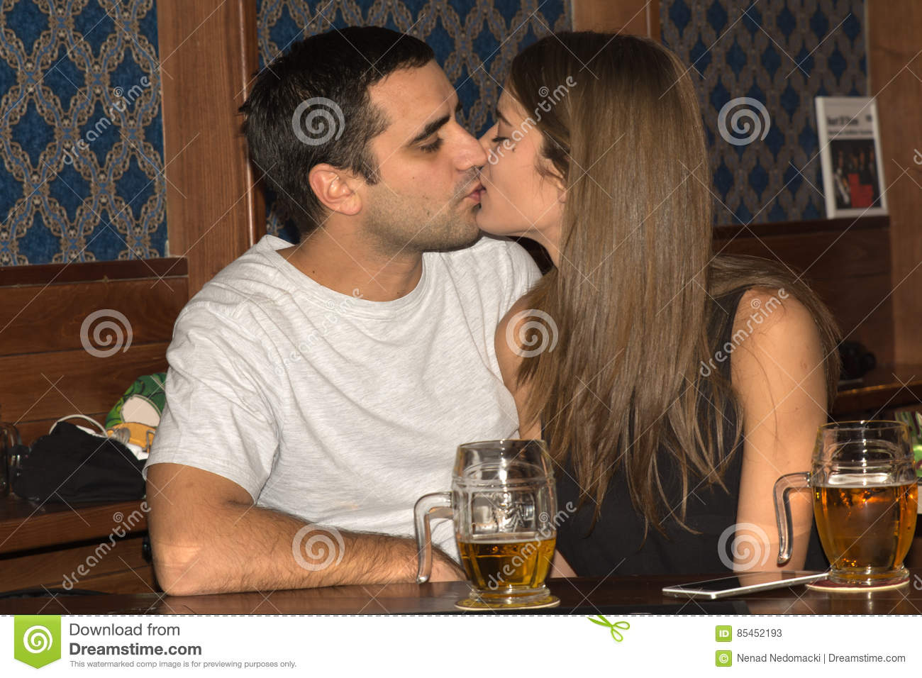 Couple drinking and having fun together
