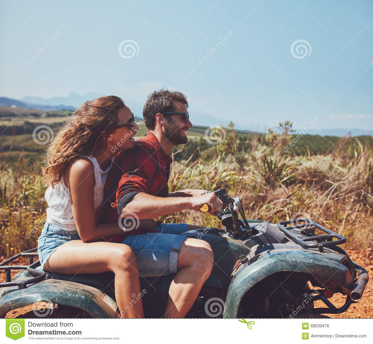 Couple Enjoying Their Summer Holidays Stock Photo: Couple Driving Off-road With Quad Bike Stock Photo