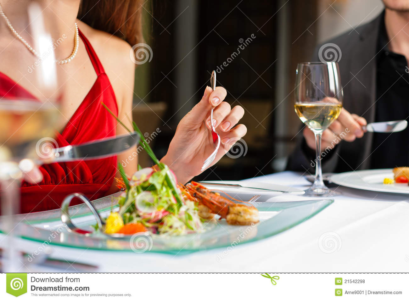 Couple eating dinner in very good restaurant royalty free for Romantic food