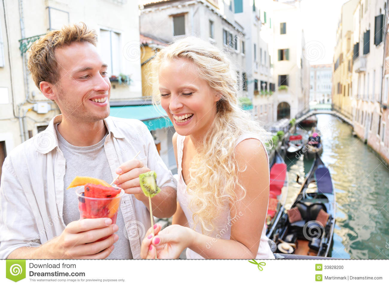 Couple Eating Fruit Snack In Venice Stock Photo Image